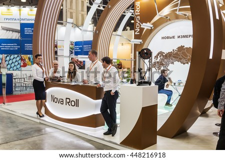 "RUSSIA, MOSCOW - June 14, 2016: Visitors and exhibitors visiting the stands and exhibits at the exhibition ""RosUpack"" at Crocus Expo. Exhibition held in Moscow. International Exhibition."
