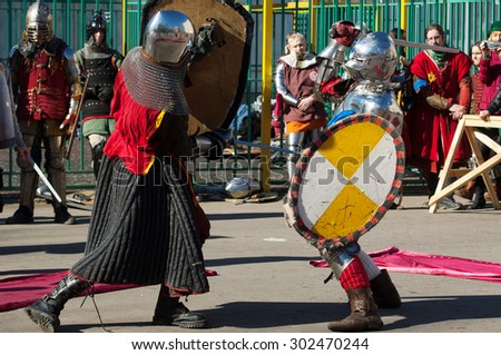 RUSSIA, MOSCOW - MARCH 14: Unidentified knights fight on tournament on history reenactment of the Medieval maneuvers in Moscow, 14 March, 2015, Russia - stock photo