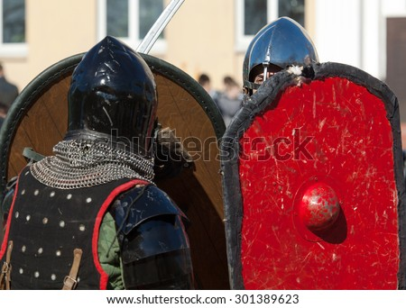 RUSSIA, MOSCOW - MARCH 14: Unidentified knights under shields protection on  tournament on history reenactment of the Medieval maneuvers in Moscow, 14 March, 2015, Russia