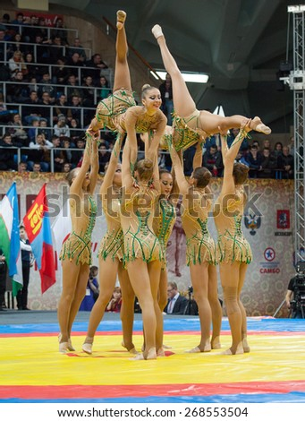 RUSSIA, MOSCOW - MARCH 27: Unidentified sportsmen of Russian national gymnastics aesthetic team dance on World Sambo Championship Kharlampiev memorial in Luzhniki sport palace, Moscow, Russia, 2015 - stock photo