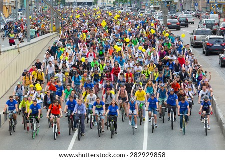 RUSSIA, MOSCOW - MAY 31, 2015 - Cyclists on the Moscow cycle parade. Cycle parade took place in support of development of bicycle infrastructure and for safety on roads. - stock photo