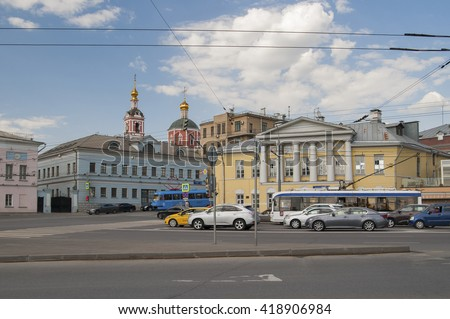 RUSSIA, MOSCOW - MAY 11, 2016: View of the Yauzskaya street with beautiful architecture and a part of the Peter and Paul Church. - stock photo