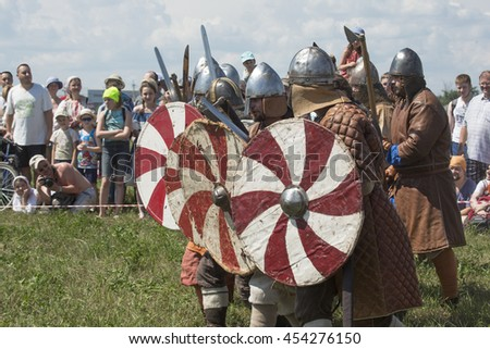 Russia, Moscow region, village Dushonovo-July 02, 2016: The Military-historical festival. The Vikings attack with raised swords.
