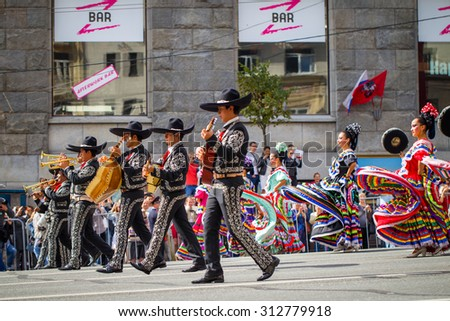 "Russia, Moscow, Tverskaya street, 6 September 2014 - the festival of military orchestras ""Spasskaya Tower"" - a procession of military bands and the audience. Mexican artists. Colorful costume show."