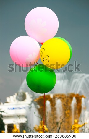 Russia, Moscow, VVC (ENEA) All-Russian Exhibition Centre, 4 May 2011 - May Day celebrations, Fountain Friendship of Peoples. Air balloons. Stormy sky. - stock photo