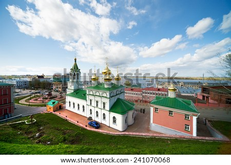 RUSSIA, NIZHNY NOVGOROD - APR 30, 2012: View from height to Church Of The Nativity Of John The Baptist. This church was destroyed during the Soviet era and the newly restored. - stock photo