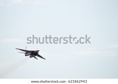 "Russia, Perm, June 2014 Aerobatic team ""Strizhi"" on military aircraft of the supersonic interceptor MiG-29 at the festival ""Wings of Parma - 2014"" in Perm at the airfield ""Sokol"""