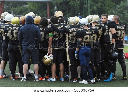 RUSSIA, PODOLSK CITY - JULY 27, 2013: Football team Spartans rejoice just after friendship football game Spartans vs Vityazi in Moscow region, on stadium Planet, Podolsk city, Russia