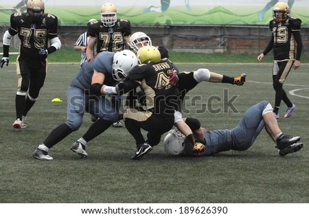 RUSSIA, PODOLSK CITY - JULY 27: G. Shevko (40) atack the enemy on friendship football game Spartans vs Vityazi on July 27, 2013, in Moscow region, Podolsk city, Russia - stock photo
