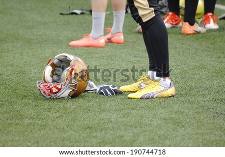 RUSSIA, PODOLSK CITY - JULY 27: Helmet on grass during friendship football game Spartans vs Vityazi on July 27, 2013, in Moscow region, Podolsk city, Russia - stock photo