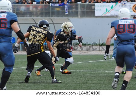 RUSSIA, PODOLSK CITY - JULY 27: K. Shchurenko (52) in action on friendship football game Spartans vs Vityazi on July 27, 2013, in Moscow region, Podolsk city, Russia - stock photo