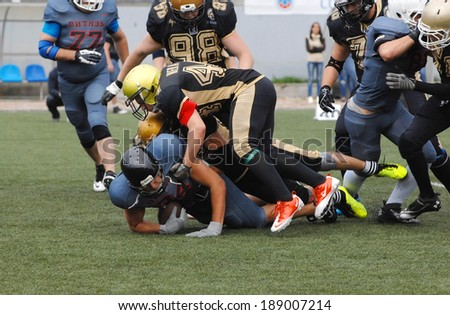 RUSSIA, PODOLSK CITY - JULY 27: S. Merja (44) defends on friendship football game Spartans vs Vityazi on July 27, 2013, in Moscow region, Podolsk city, Russia - stock photo