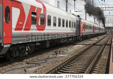 "RUSSIA; ROSTOV-ON-DON - MAY 9 -  The departure of a passenger train with a steam locomotive P 36 ""The General"" on May 9, 2015 in Rostov-on-Don"