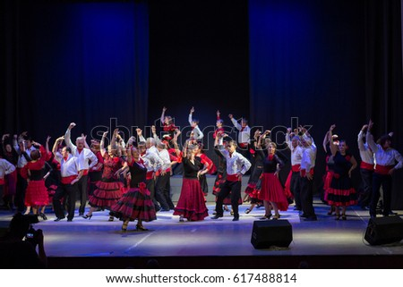 RUSSIA, RYAZAN - DECEMBER 11, 2016: V RUSSIAN FESTIVAL FLAMENCO. Mass dance of the elderly. Red, white, black style.