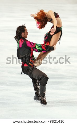 Russia's ice dancers Jana Khokhlova and Sergei Novitski perform the original dance during the ISU Grand Prix in Bercy, Paris, France. This is pairs original (Gypsy) dance for season 2007/2008. - stock photo