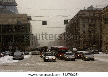 Russia, Saint Petersburg - November 9, 2016: snow storm Blizzard in megapolise. streets of city with traffic jams