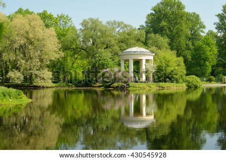 Russia.Saint-Petersburg.Rotunda-gazebo in the Park, the Ekateringofka stands on the shore of the pond.Park-a favorite place of citizens. - stock photo