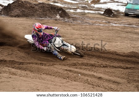 RUSSIA, SAMARA - APRIL 8: Biker A. Nikishkin, motocross racing driver at the turning in the deep sandy ruts and large inclination motorcycle, the Motocross practice April 8, 2012 in Samara, Russia