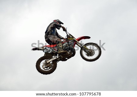 RUSSIA, SAMARA - JUNE 11: High flight of motorcycle racer A. Stepanov  on the background of clouds the Open class the Regional Motocross Championship on June 11, 2012 in Samara, Russia - stock photo
