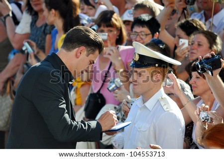 "RUSSIA, SOCHI - JUNE 3: Actor Dmitry Dyuzhev gives autographs to fans at the Open Russian Film Festival ""Kinotavr"" on June 3, 2012, Sochi, Russia"
