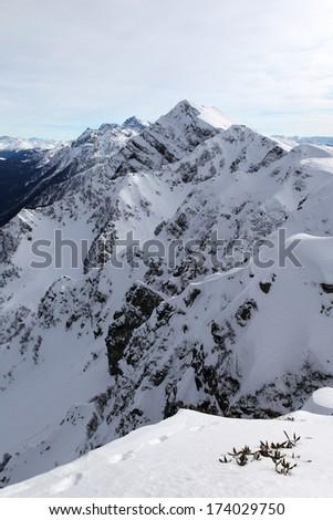 Russia. Sochi. Krasnaya Polyana. Ridge Aibga. Mountains in snow. - stock photo