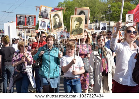 Russia, St. Petersburg 09,05,2016 Immortal Regiment - people with portraits of their relatives, participants in the Second World War, on the Victory Day parade