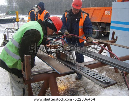 RUSSIA, SURGUT, NOVEMBER 26, 2008: Construction of an oil and gas pipeline. Industrial equipment.