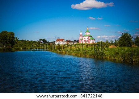 Russia. Suzdal. View of the river Kamenka and Church of St. Elias  - stock photo