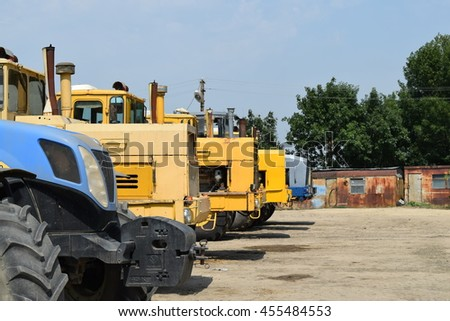 Russia, Temryuk - 15 July 2015: Tractor, standing in a row. Agricultural machinery. Parking of agricultural machinery.