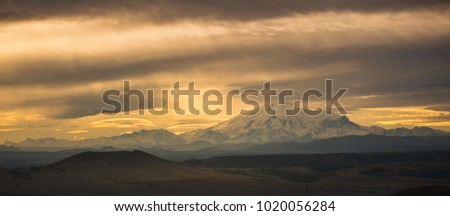 Russia, the Caucasus Mountains, Kabardino-Balkaria. The mountain ridge of the Caucasus is cloudy in the morning.