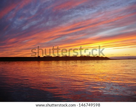 Russia. The end of August. The Urals region. Sunset on the river Usa.