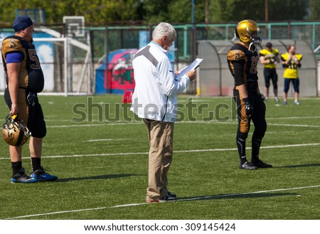 RUSSIA, TROITSK CITY - JULY 11: Alexey Geets, head trainer of Spertans team on Russian american football Championship game Spartans vs Raiders 52 on July 11, 2015, Troitsk city, Russia