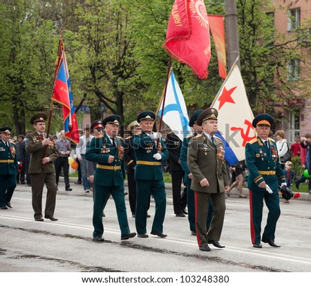 RUSSIA, VLADIMIR - MAY 9: Ceremonial parade dedicated to the 67th Anniversary of victory from  World War II event May 9, 20012 in Vladimir, Russia.   Senior military officer walks in main street - stock photo