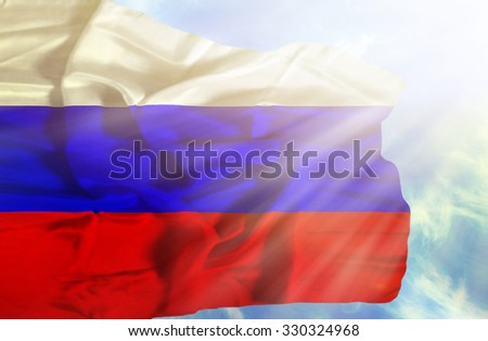Russia waving flag against blue sky with sunrays - stock photo