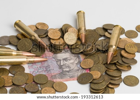 Russian and Ukrainian paper money , coins and bullets.