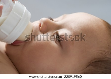 Russian baby drinking from bottle