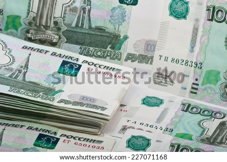 Russian banknotes on the table as background - stock photo