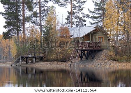 russian bathhouse(sauna) on the bank of the lake, bridges in the lake, Karelia, Russia - stock photo