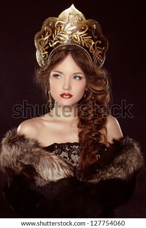 Russian Beauty. Attractive female wearing in kokoshnik. Woman's headdress in old Russia - stock photo