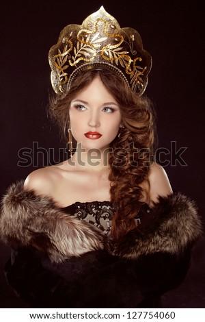 Russian Beauty. Attractive female wearing in kokoshnik. Woman's headdress in old Russia - stock photo
