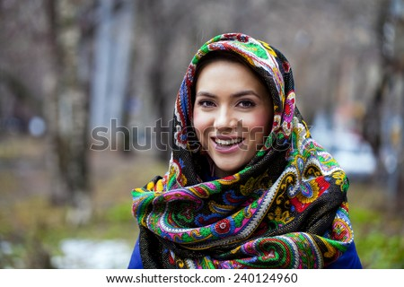 Russian beauty woman in the national patterned shawl - stock photo