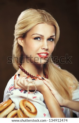 Russian blonde girl in national dress - stock photo