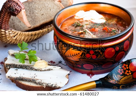 Russian borscht (soup with cabbage and red beet) - stock photo