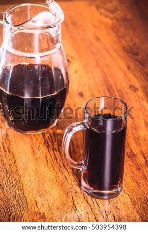 Russian brew in mug and jug of rye  flour on wooden background