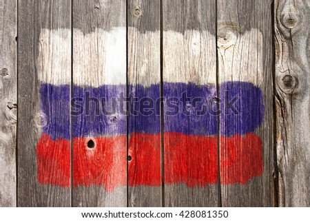 russian colors on old wooden wound