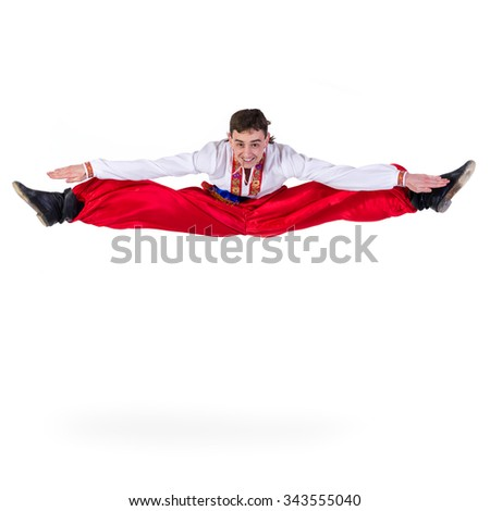 Russian cossack dance. Young dancer in ethnic clothes jumping,  full length portrait isolated over white background - stock photo
