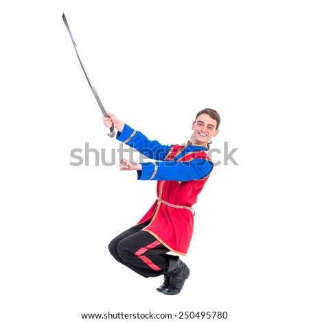 Russian cossack dance. Young dancer in ethnic clothes  posing with sword,  full length portrait isolated over white background - stock photo