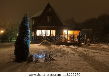 Russian county house (dacha) and decorated Christmas tree. Moscow region. Russia. - stock photo
