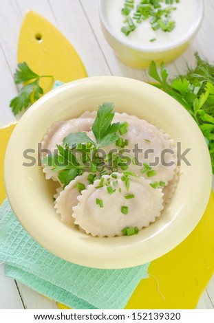 Russian dumplings boiled with dill