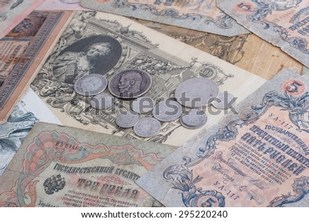 russian empire banknotes vintage background with silver coins - stock photo